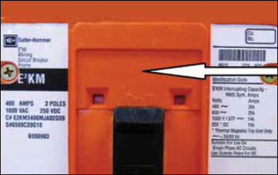 Figure 1 (Note: The arrow in Figure 1 points to an area on the frame of the suspected modified breakers that the MSHA alert notes is smooth. Originally, the E2K model had a grey cover and the E2KM model a red cover. Also, the breaker's label or frame apparently lacks the mark of a qualified Nationally Recognized Testing Laboratory (NRTL). OSHA knows of no other exterior means of identification.)