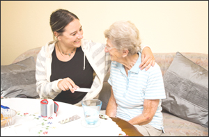Healthcare worker with elderly woman