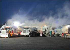 Silica dust clouds from delivery trucks loading into sand movers Photo credit: NIOSH