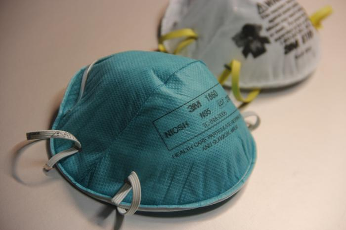 Acceptable respiratory protection devices for protection against MERS-CoV include a properly fit-tested, NIOSH-approved filtering face piece respirator (N95 or higher level), half- or full-face air-purifying respirator (APR), or a powered air-purifying respirator (PAPR) equipped with high-efficiency particulate arrest (HEPA) filters. A N95 filtering face piece respirator is shown.