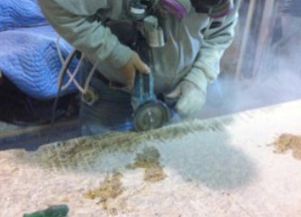 Cutting stone, as pictured, generates dangerous crystalline silica dust that can become trapped in lung tissue and cause silicosis.