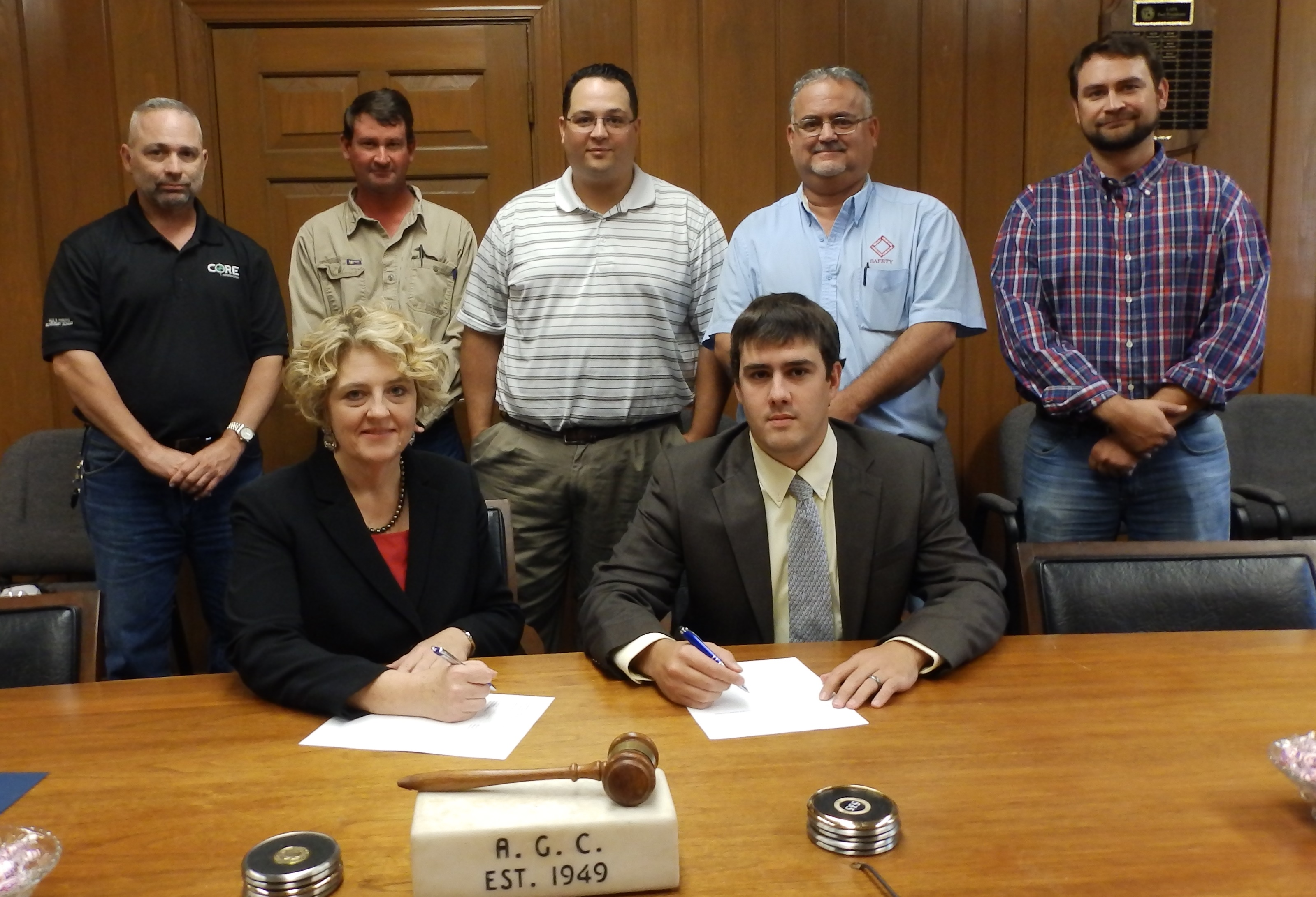 Dorinda Folse (front left), area director in Baton Rouge for the U.S. Department of Labor's Occupational Safety and Health Administration, and Michael Demouy (front right), manager, Louisiana Associated General Contractors, renewed a commitment to help keep workers safe.