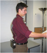 Employee wearing an air sampling pump and sorbent tube.