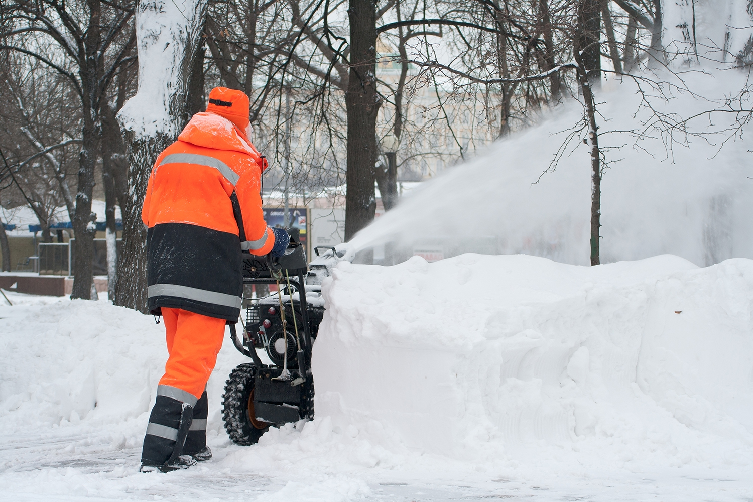 Image of worker clearing heavy snow with a snow-blower | photo credit: iStock