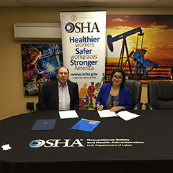 Elizabeth Linda Routh, area director of OSHA's Lubbock Area Office and Phil Young, executive director for the West Texas Safety Training Center sign a three-year alliance renewal agreement at the Midland training center
