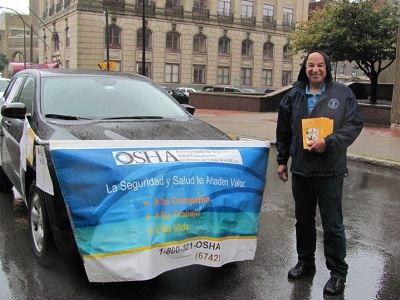 William Soto of OSHA's Buffalo office promotes workers' safety and rights at Puerto Rican and Hispanic Day Parade of Western New York
