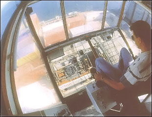 Figure 2. Container gantry operator working a vessel.