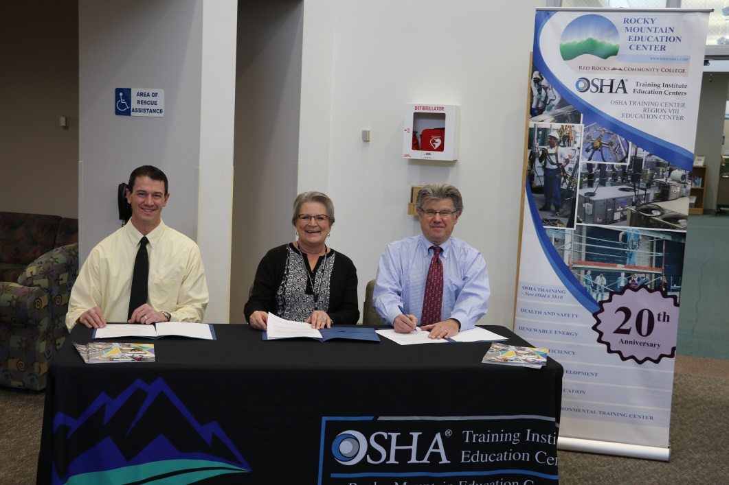 Chad Vivian, acting area director of OSHA's Englewood Area Office; Joan Smith, executive director of the Rocky Mountain Education Center and Herb Gibson, area director of OSHA's Denver Area Office sign an alliance to promote safety training and education