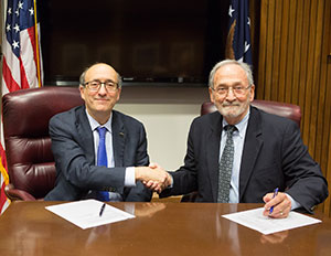 Then-Assistant Secretary Dr. David Michaels, USDOL-OSHA, with J.D. Lormand, Executive Director, APCA, at the alliance renewal signing ceremony on October 15, 2015.