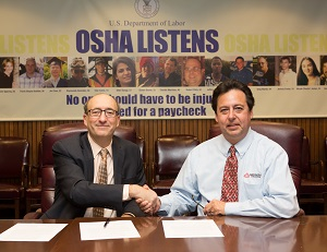 (L to R) then-Assistant Secretary Dr. David Michaels, USDOL-OSHA; and Gus Anibarro, Education Director, LIA sign a national Alliance renewal agreement on December 18, 2014.