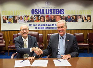 Then-Assistant Secretary Dr. David Michaels, USDOL-OSHA and J.A. McMaster, President, Preparedness and Health and Safety Services, American Red Cross, at the alliance renewal signing on November 9, 2015.