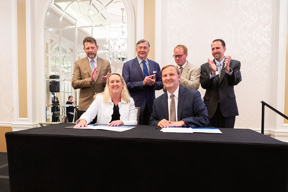 Loren Sweatt, Deputy Assistant Secretary, DOL-OSHA and Corey Rosenbusch, President and CEO, GCCA (both seated), with GCCA representatives at the Alliance renewal signing ceremony on July 31, 2019.