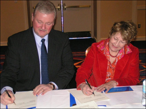 (From left to right) Robert Baker, Director, Keene State College, OSHA Training Institute Education Center and Marthe B. Kent, Regional Administrator, Region I, USDOL-OSHA, sign the Alliance agreement on February 25, 2009.