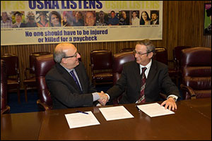 (L to R) Then-Assistant Secretary Dr. David Michaels, USDOL-OSHA, and Marty Coughlin, President, SAIA, sign a national Alliance renewal agreement on December 18, 2013.