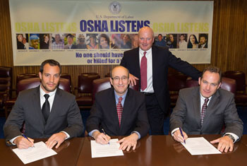 (L to R) Doug DeSilvio, Worker Representative, SWR Institute; then-Assistant Secretary Dr. David Michaels, USDOL-OSHA; Jim Dougherty, Safety Committee Member, SWR Institute; and Dave Grady President, SWR Institute sign a national Alliance renewal agreement on March 20, 2014.