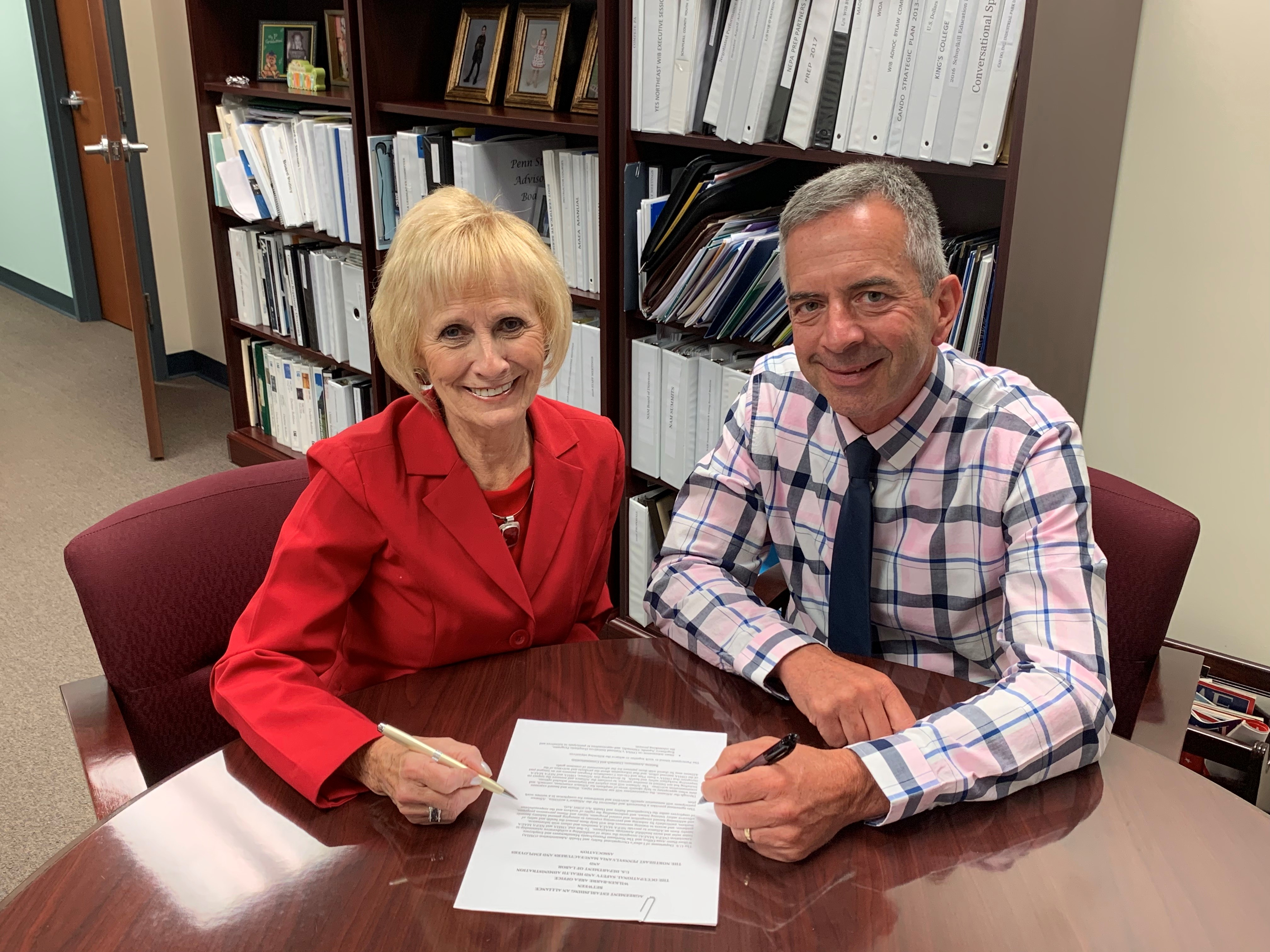 Mark Stelmack, Area Director, DOL-OSHA Wilkes-Barre Area Office and Darlene Robbins, President, NPMEA sign the alliance agreement on August 15, 2019.