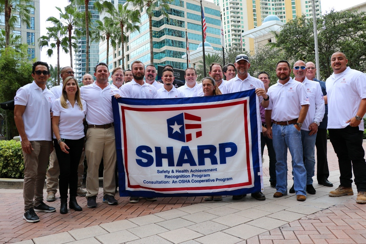 Stiles Construction Team on the R.O.L.O. project with SHARP Flag