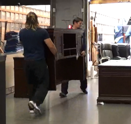 Figure 1 - workers carrying furniture