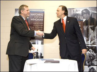 Edwin G. Foulke, Jr., former Assistant Secretary of Labor, OSHA (left) and William C. Anderson, Assistant Secretary of the Air Force, Installations,Environment and Logistics (right), shake hands after the signing of the national USAF OSP agreement on August 27, 2007.