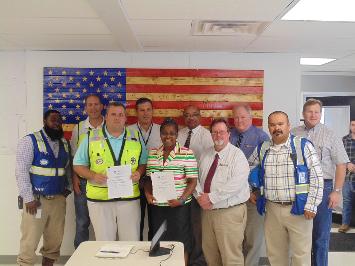From Left to right: Mr. Rodney Cook (Holder Construction Group, LLC- Senior Safety Coordinator), Mr. Chris Paine (Holder-Senior Superintendent), Mr. Corey M. Lemming (Holder- Senior Project Manager), Mr. Jorge Cisneros (Holder- Corporate Safety Director), Mrs. Ramona Morris ( Birmingham OSHA Office Area Director), Mr. Hector Julian-Camacho (Birmingham OSHA Office Assistant Area Director), Mr. Matt Hollub (University of Alabama – SafeState, On-Site Consultation Program), Mr. Randy M. Easterling (University of Alabama – SafeState, Safety Program Supervisor), Mr. Marco Polo Chantres (Holder- Safety Director), Mr. John P. Redmond (Holder- Vice President).