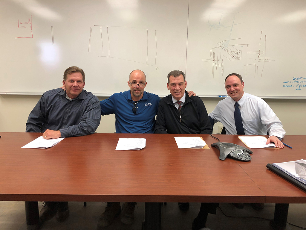 (left to right) Chris Robinson, Area Director, Pittsburgh Area Office, US DOL-OSHA; Tom Melcher, Business Manager, Pittsburgh Regional Building Trades Council; John Mascaro Jr., CEO, Mascaro Construction Company and Todd Ketola, Management Representative, Barton-Malow.