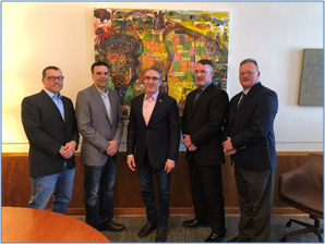 From left: Jesse Olson and Jason Tuhy of the Whiting Petroleum/Bakken Basin Safety Consortium; North Dakota Governor Doug Burgum; OSHA Bismarck Area Office Director Scott Overson; and OSHA Bismarck Assistant Area Director John Young gathered to sign an alliance to promote safety and health in the North Dakota oil and gas industry.