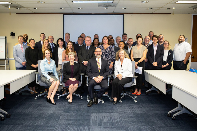 Acting Deputy Assistant Secretary, Galen Blanton, USDOL-OSHA, (Seated Row, Third from the Left), and members of the OSHA Alliance Program Construction Roundtable on September 20, 2018.