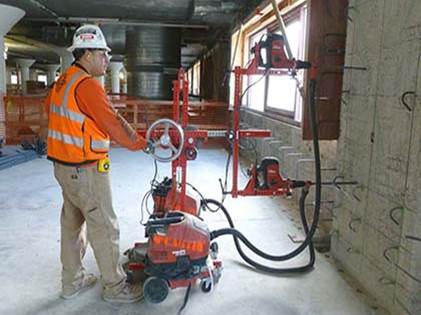 Contractors adopt innovative concrete drill jig to reduce silica exposures during concrete drilling operations. | Source:  UC Ergonomic Research and Graduate Training Program