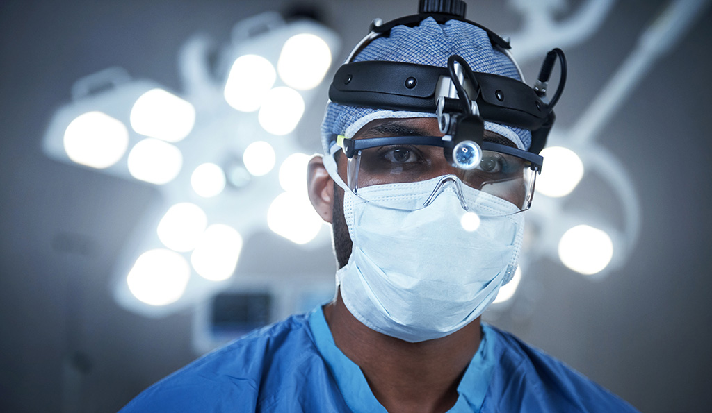 Shot of a surgeon wearing a surgical cap, mask and goggles | Photo Credit: iStockphoto-592648050 | Copyright: shapecharge