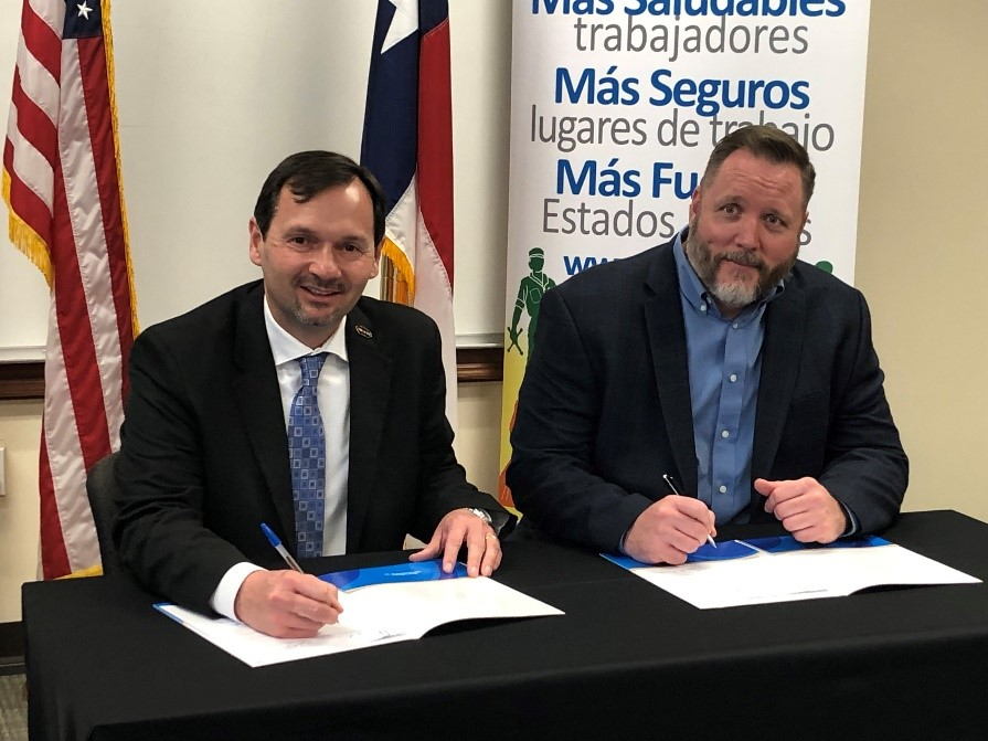 OSHA Regional Administrator Eric Harbin and Damage Prevention Council President John Sparks sign two-year alliance to help keep workers in trenching and excavation operations safe.