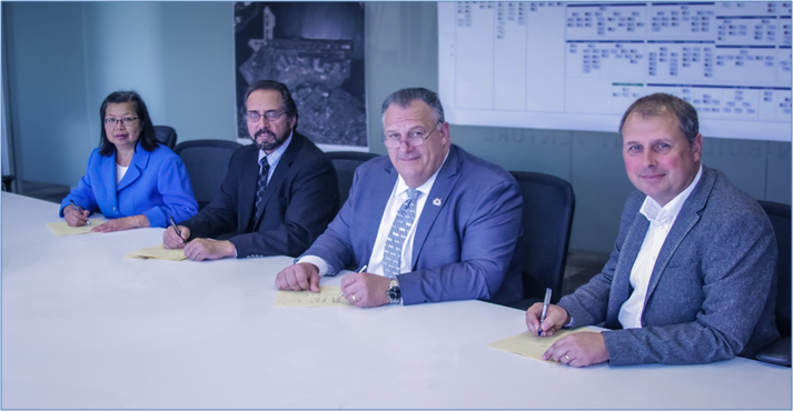 From left: OSHA Manhattan Area Director Kay Gee; OSHA Regional Administrator Robert Kulick; President, Building & Construction Trades Council of New York, Gary LaBarbera; Skanska Vice President and Skanska Walsh Chief Executive Thomas Nilsson agree to a partnership for the redevelopment project at LaGuardia Airport.
