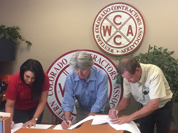 (From Left) Western Colorado Contractors Association (WCCA) Executive Director Shawna Grieger, OSHA Denver Area Director Herb Gibson, and WCCA President Dan Quillen sign two-year alliance.