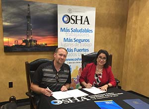 Elizabeth Linda Routh, OSHA area director, Lubbock Area Office and John R. Fehr, president of the Fehr's Metal Building Construction, LLC sign a two-year alliance renewal agreement at the Fehr's facility in Seminole, Texas Source: OSHA Region 6