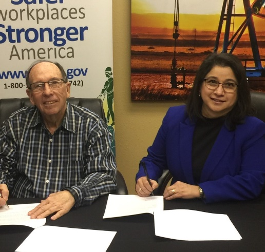 Phil Young of West Texas Safety Training Center and Lubbock Area Director Elizabeth Routh sign alliance to protect oil and gas employees.