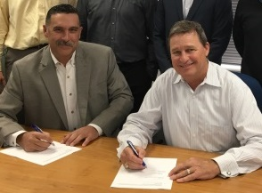 OSHA Area Director Travis Clark (left) and McCarthy Building Companies President Jim Stevenson recently signed an alliance to help protect employees involved in construction at Christus Spohn Hospital in Corpus Christi.