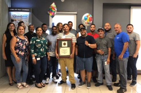 Simmons Caribbean Bedding employees with their SHARP plaque.