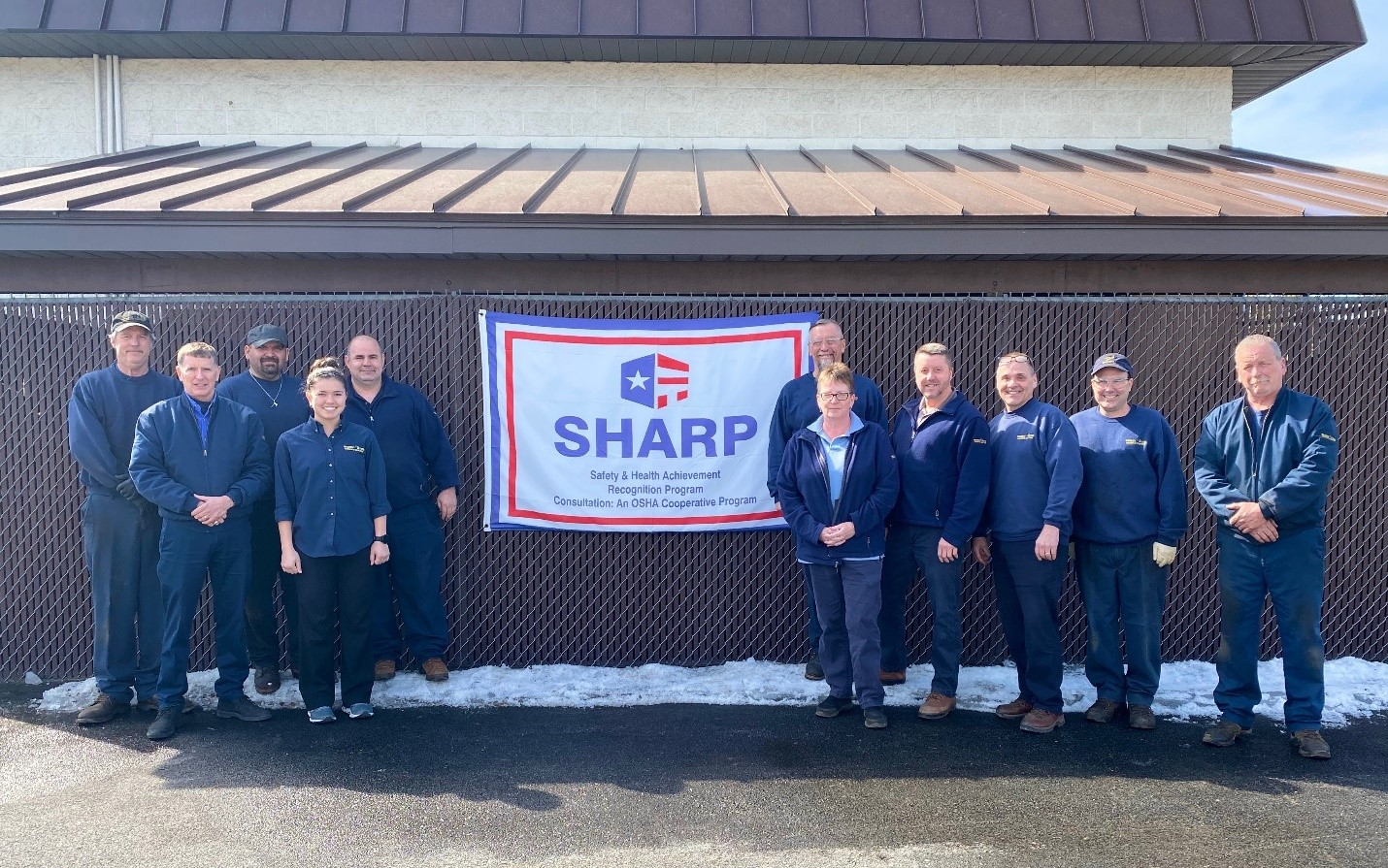 Warren Tire employees proudly celebrate SHARP accomplishment (from left to right): Dan Mulcahy, Chris Skogsberg, Bob Kellogg, Megan Kellog, Glen Wetherby, Rae Butler, Chad Sucese, Dan Mallory, Randy Facto, Scott Danahy, and Steve Larose.