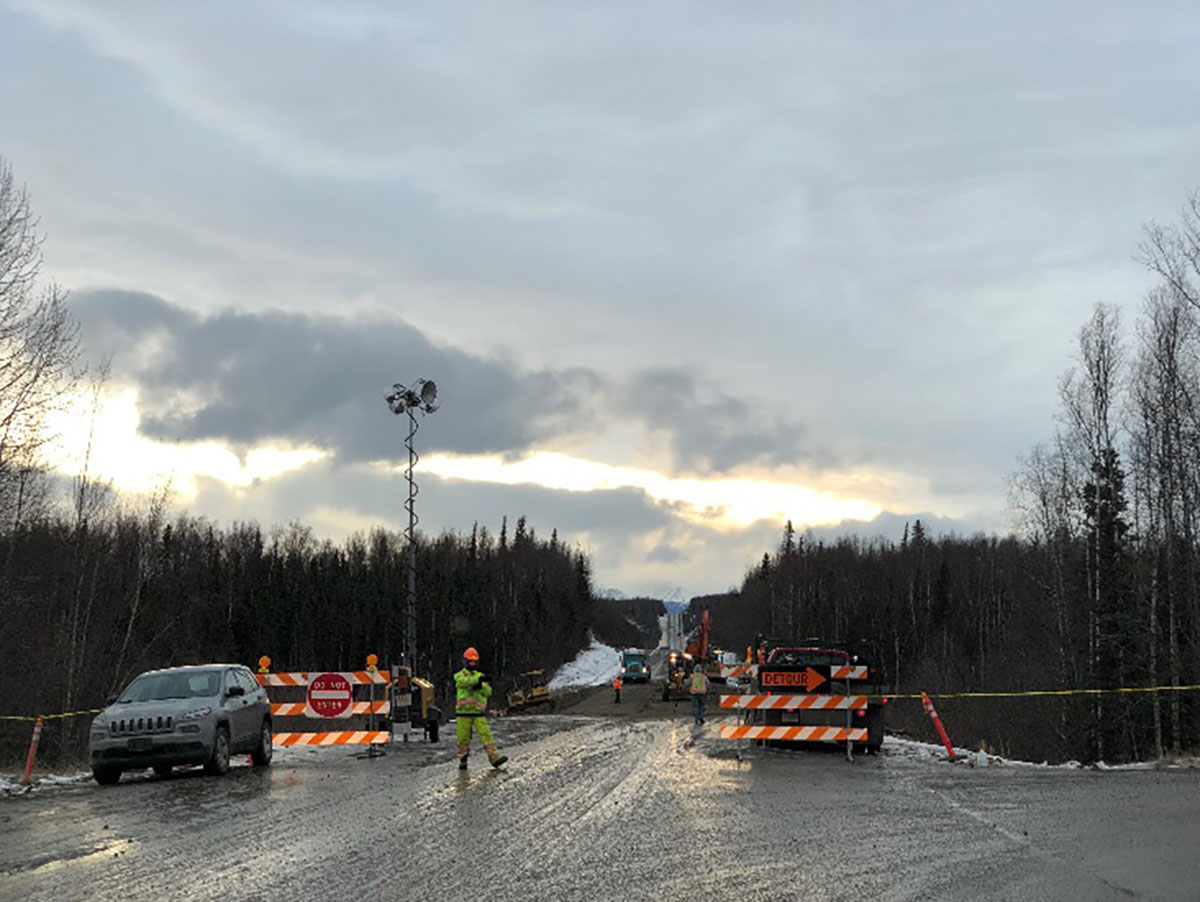 Roadwork being performed on Vine Road in Wasilla. This section of road was heavily damaged, including utility lines running parallel to the road. Repairs are being done safely.