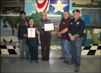 Safety Committee Poses with DeBourgh's Eighth SHARP Cycle Plaques (2/2/2011). (L-R) Christopher Quackenbush, Powder Coater, Charlene Hernandez, Night Shift Supervisor, Janet Berg, Corporate Administrative Officer, Bill Pohlen, Facility Manager, Larry Knaggs, Safety Director/Maintenance.