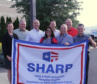 From left to right: Kate Otis (community relations), Geoffrey Holodook (NYS SHARP Coordinator), Ray Cordani (Safety and Loss Prevention Manager), Aileen Flach (VP of HR), Carmine DeCrescente III (VP), CJ DeCrescente (President), Tom Turcotte (VP of Operations) , Russ Teplitzky (general manager)
