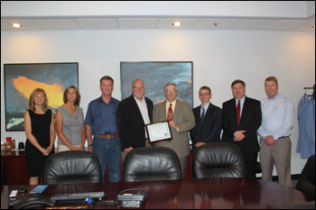Presentation of SHARP certification at EE Technologies, Inc. From left to right, Karla Osorno - Business Development, Laura Anderson - Human Resource Supervisor, Rick Pink - Facilities Team Lead/Safety Manager, Sonny Newman - President, Don Jayne - Administrator of Division of Industrial Relations (at the time of the photo), John Lindgren - Safety Representative from SCATS, Andy Giddings - Consultation Supervisor from SCATS, and Clay McElhany - Director of Operations.