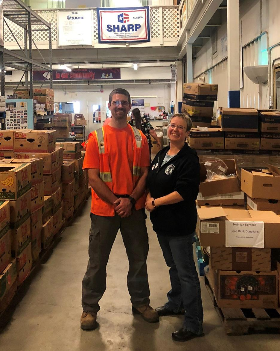 Philip Weaver and Anne Weaver in the food bank warehouse