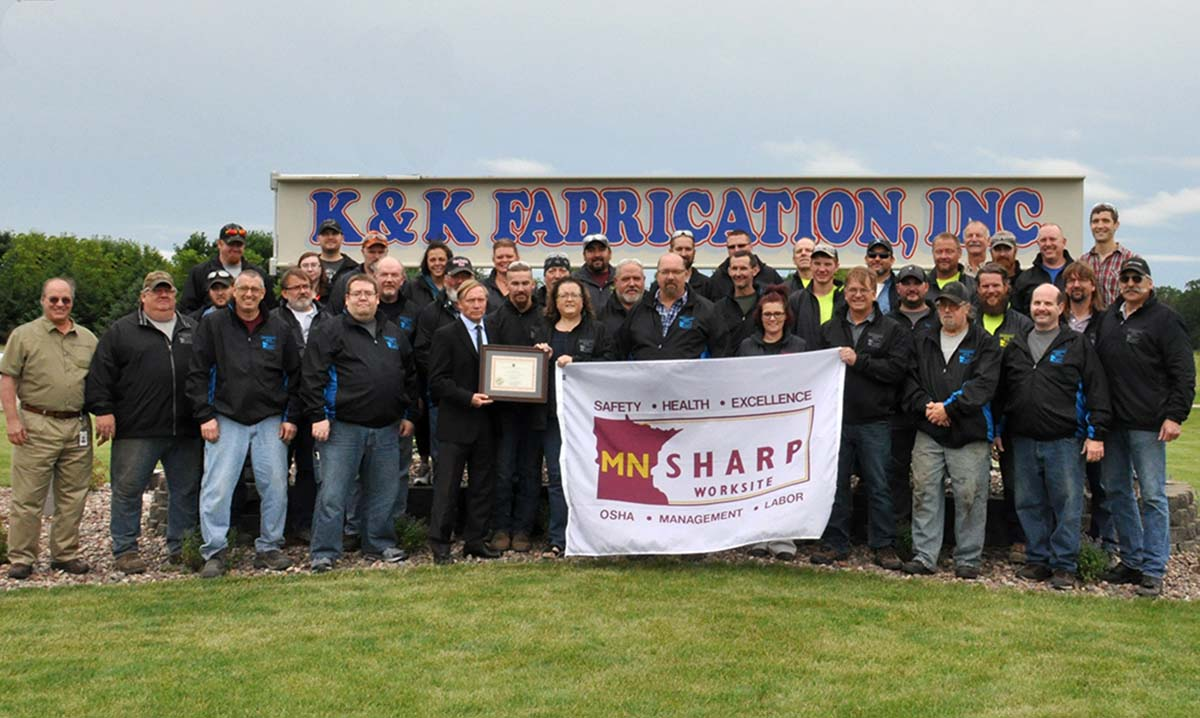 K&K Fabrication Team with SHARP Certificate and Flag