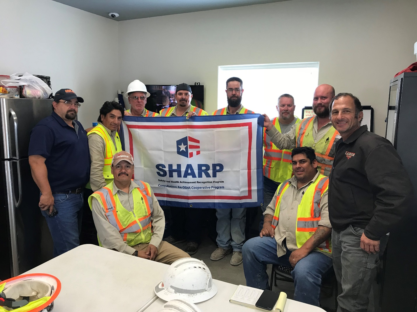 Spicewood Plant SHARP Team <small>Standing (Left to Right): Jimmy Grubbs, Jerry Amaya, Ron Harpster, Larry Stephens, Ryan Gilley, Greg Wicsinger, Anthony West, and Silvio Filipovich. Seated (Left to Right): Manuel Bega and Lozano Salvador</small>