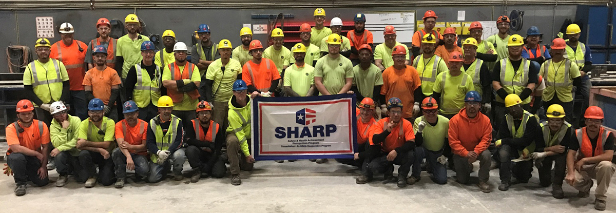 Mid-States Concrete Industries Team Accepting Their OSHA SHARP Flag