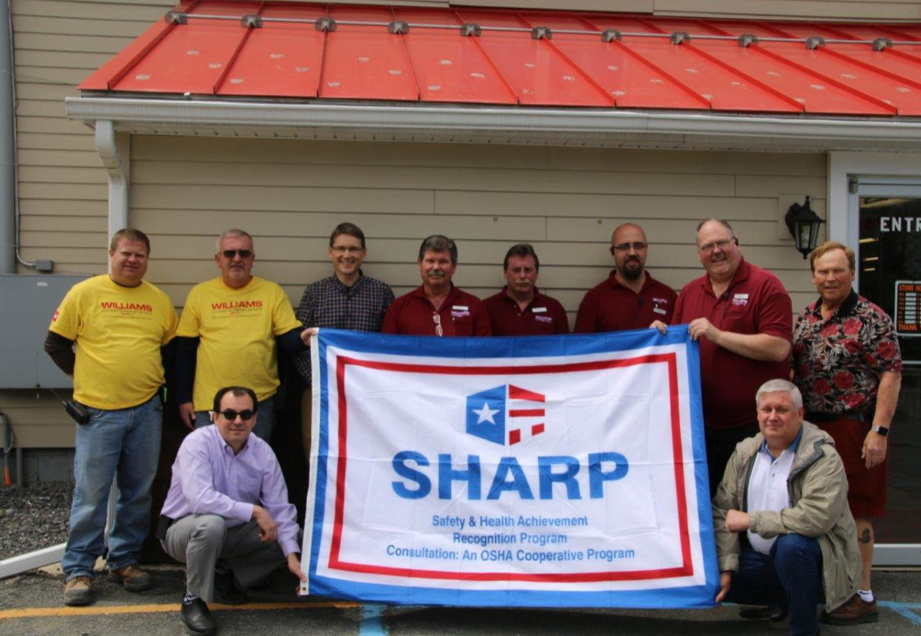 Williams Lumber & Home Centers Team Celebrates Earning SHARP Recognition  (Left to Right: T.J. Keeler, Kevin Blair, Jim Cataquet (kneeling), Tom Jozefowicz, Gary Strompf, Darryl Muller, Mike Staccio, Rich Fitzgerald, Geoff Holodook (kneeling), Sandy Williams)