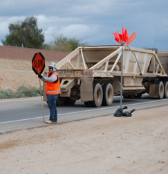 female construction worker with slow sign