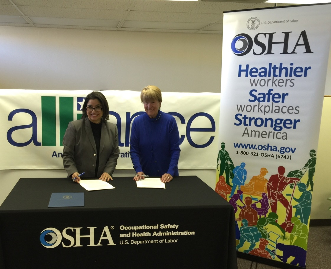 Photo Credit: OSHA | Copyright: Public Domain | Elizabeth Linda Routh, area director for OSHA's Lubbock Area Office and Sandra Webb, executive director for the Associated General Contractors panhandle of Texas Chapter signing a two year alliance agreement at the AGC facility in Amarillo, Texas.