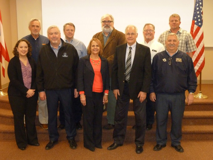 The Columbus OSHA Area Office renewed their partnership with Central Ohio NECA and IBEW locals 683 and 1105 on March 22, 2016 at The Electrical Trades Center in Columbus, Ohio. Back Row Left to Right: Randy Butcher, Atlas Industrial Electric Co,Bob Shonkwiler, The Superior Group, Steve Lipster, Director, The Electrical Trades Center, Brian Dew, Mid-City Electric Co.Dave Fetters, Royal Electric Construction Corp. .Front Row: Melissa Linton, Compliance Assistance Specialist, OSHA, John E. Moore, Business Manager, IBEW LU 683, Deborah Zubaty, Area Director, OSHA, Brian Damant, Chapter Manager, Central Ohio Chapter, NECA, Dennis Nicodemus, President, IBEW LU 683| Photo Credit: OSHA | Copyright: Public Domain