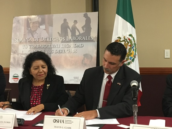 Travis Clark, director of OSHA's Corpus Christi Area Office signs alliance renewals with Consul General of Mexico, Carolina Zaragoza Flores in Laredo, Texas.